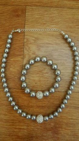 Новый комплект ожерелье с браслетом.