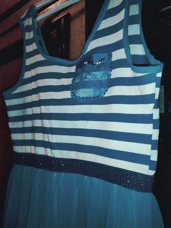 Красивое голубое платье на девушку