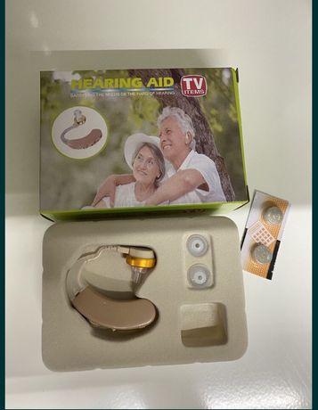 Универсальный слуховой заушной аппарат .