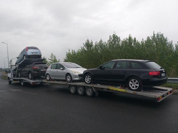 Tractari, transport auto pe platforma/Italia-Romania-Italia