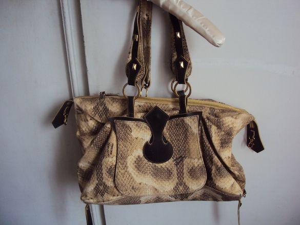 Бутикова маркова чанта на Роберто Кавали