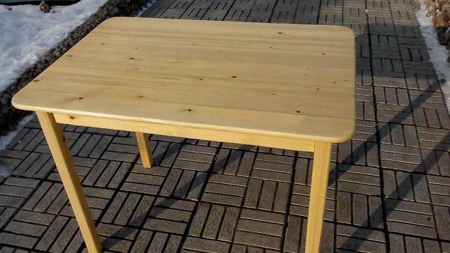 продам стол из натурального дерева. массива сосны.покрыт нц лаком