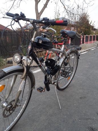 Vind bicicleta cu motor de 80 cm nou nu necesita permis