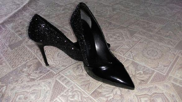 Обувки на Мегияс