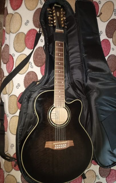Музыкальный инструмент(гитара концертная),черного цвета