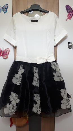 Vand rochita alb negru
