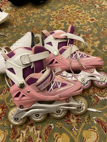 Продам роликовые коньки девочек за 6000тг.