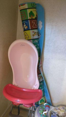 Детскую ванну , коврик ходунок столик в хорошом состояние