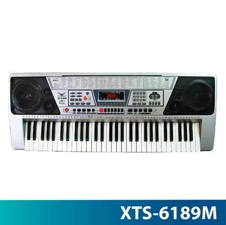 Oraga /claviatura LCD mare , 50 demo ,147 tonuri / 128 ritmuri