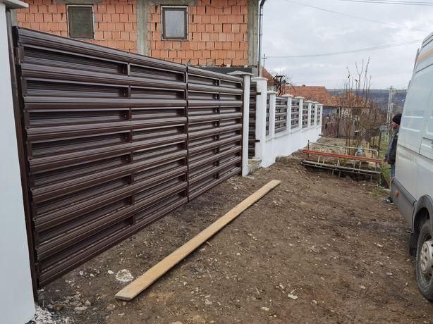 Execut porti si garduri din sipca metalica si din profile lamelare