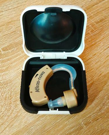 Заушной слуховой аппарат. Усилитель слуха звука.