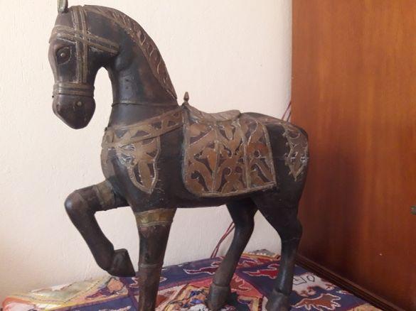 Статуетка на кон
